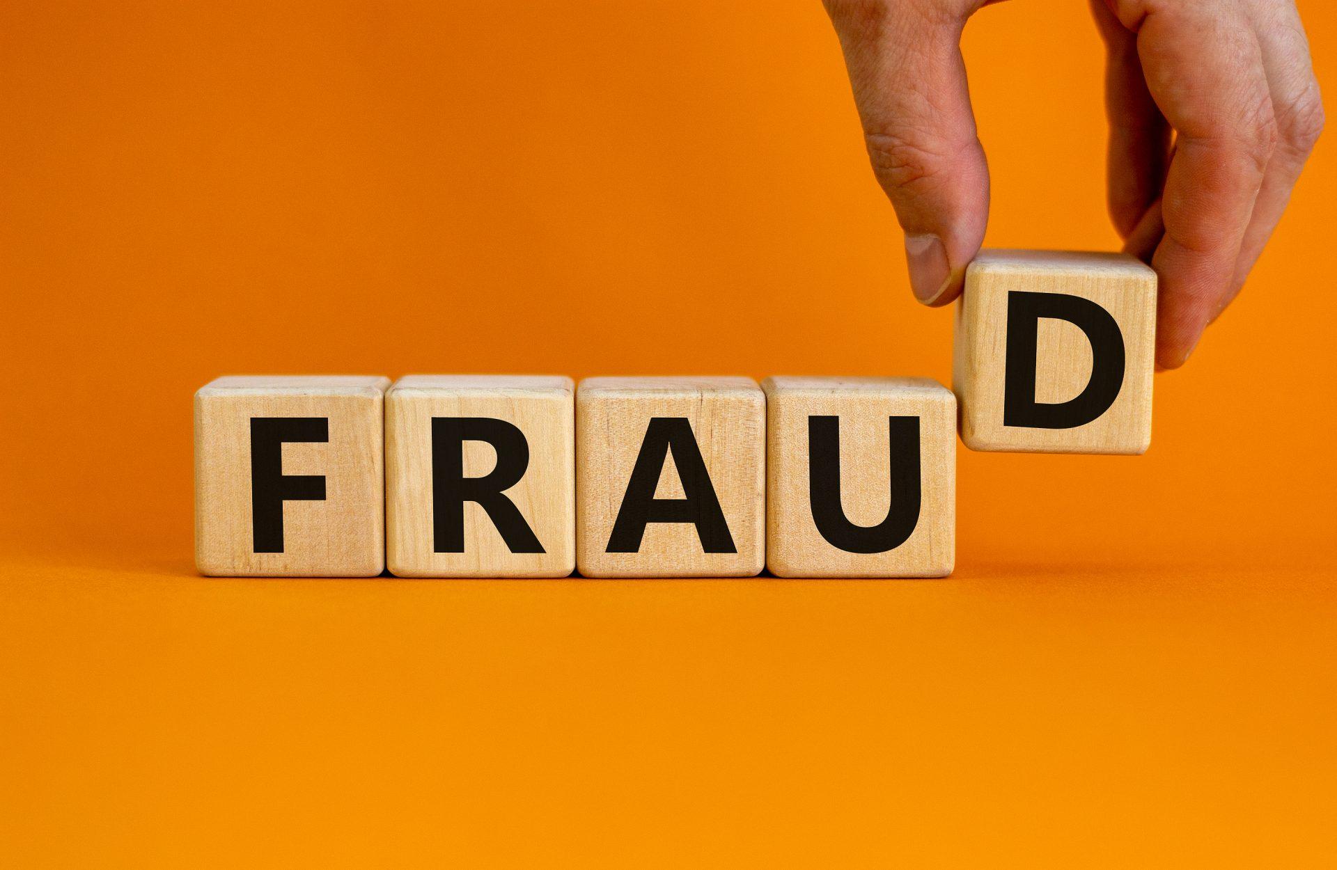 Fraud Symbol Concept with Word Blocks